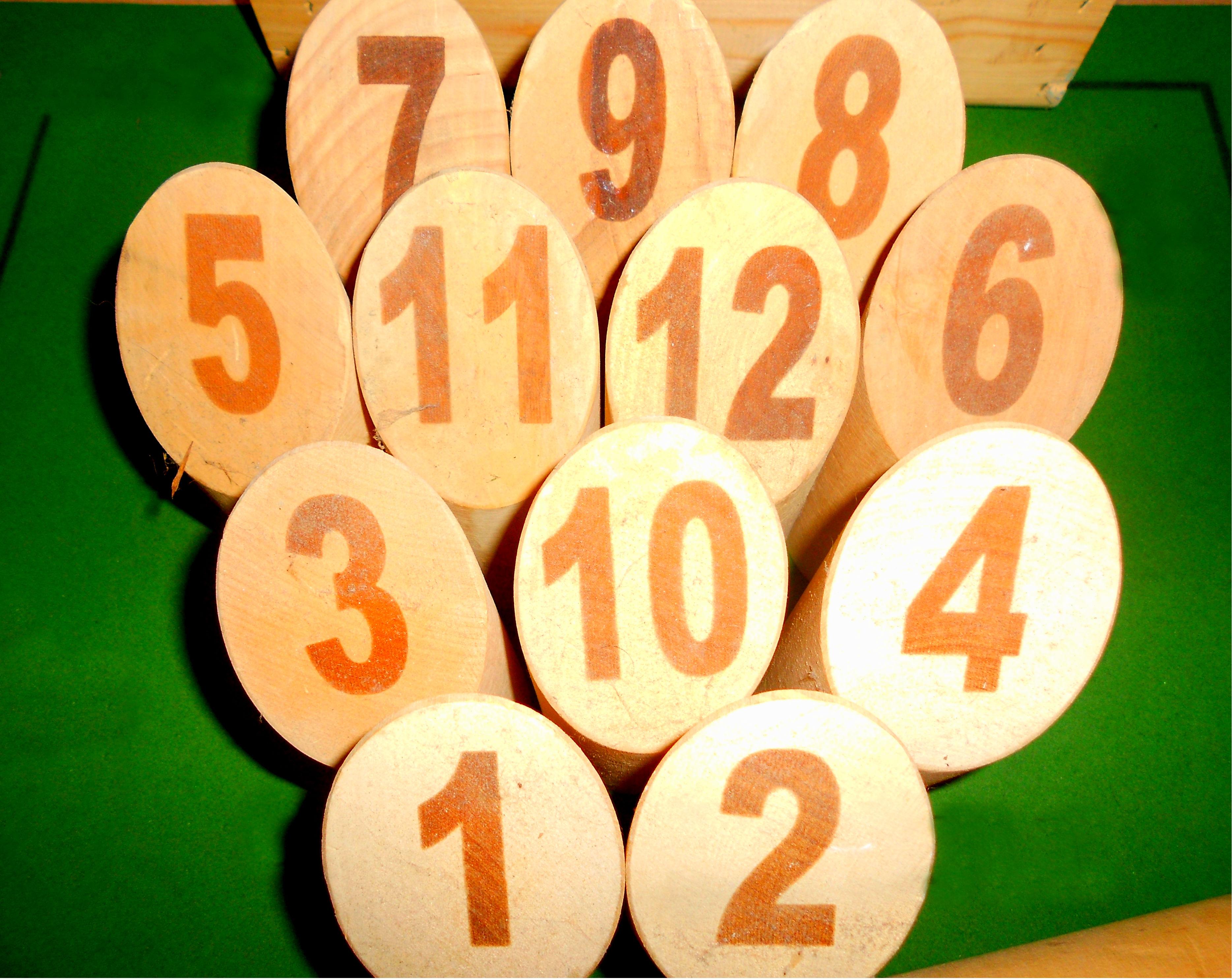 Jeux en bois molkky for Regle du jeu petanque